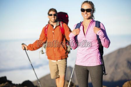 man and woman hiking on beautiful
