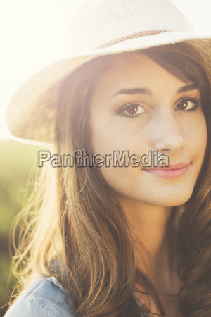 warm sunny portrait of beautiful young