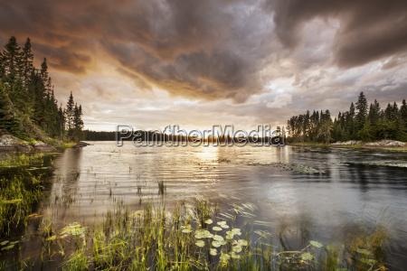 sunset over a pond thunder bay