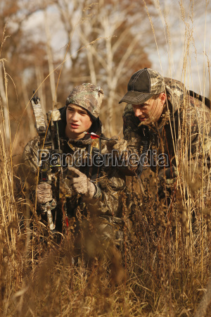 father coaches son on tracking a