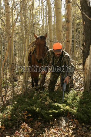 big game hunter with pack horse