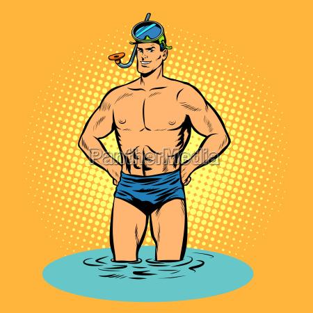 schwimmer in badehosen und maske zum