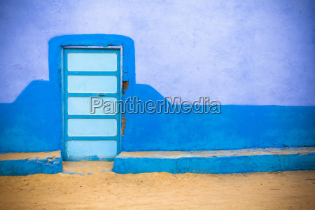 a colourful wall to a nubian