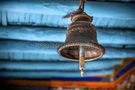 a old brass bell hangs in