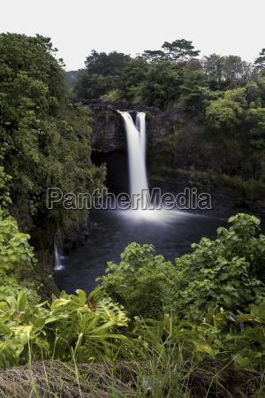 waterfall in lush foliage hawaii united