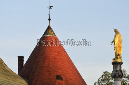a peaked cone roof with weather