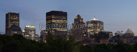 skyline of office buildings illuminated at