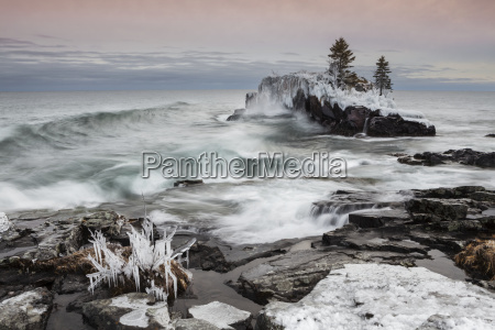 snow and ice along the shoreline