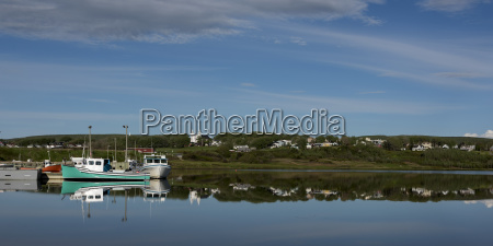 mirror image of fishing boats and