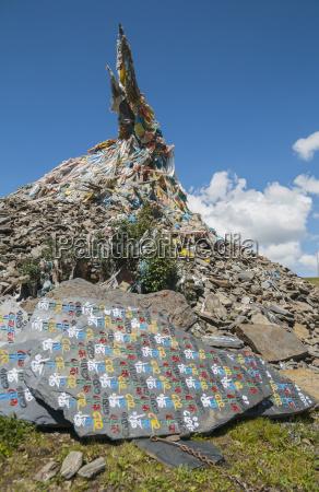 buddhist stupa and tibetan flags on