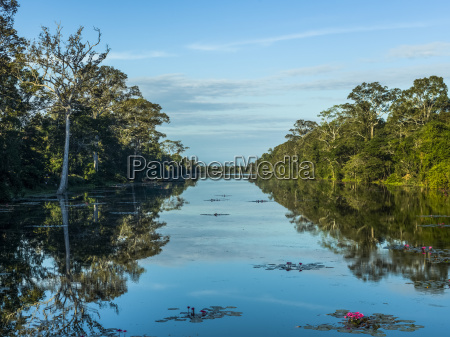 a tranquil river reflecting the blue