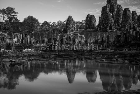 bayon temple reflected in water angkor