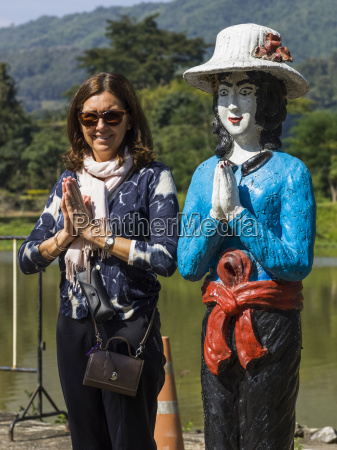 a female tourist poses in a