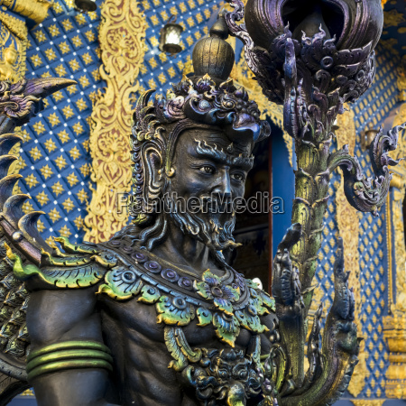 an ornate statue and facade at