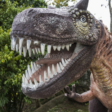 sculpture of a dinosaur with a