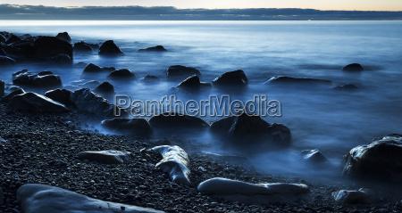 beautiful blue misty ocean washing in