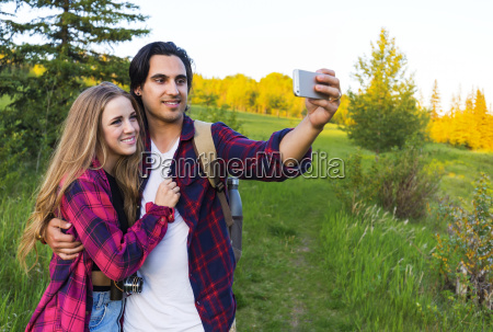 young couple in a park posing