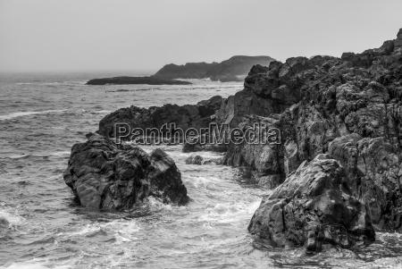 rugged rocks line the coast at