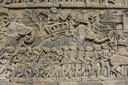 bas relief battle scene between the