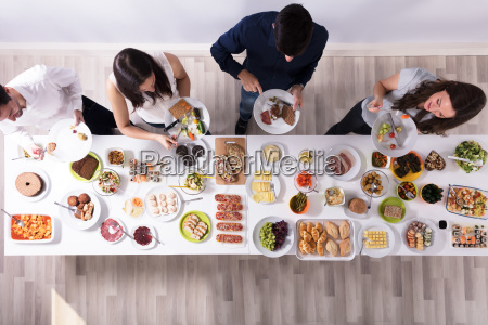 group of people eating food on