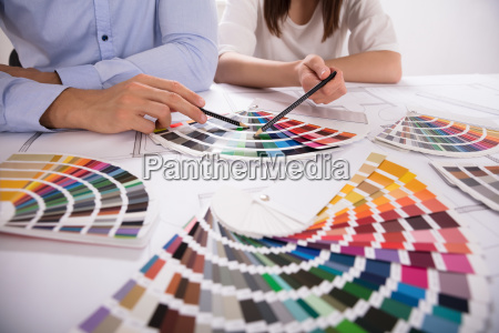 two architect choosing color from various
