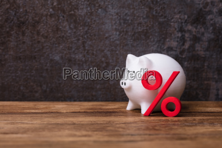 white piggybank over cubic block with