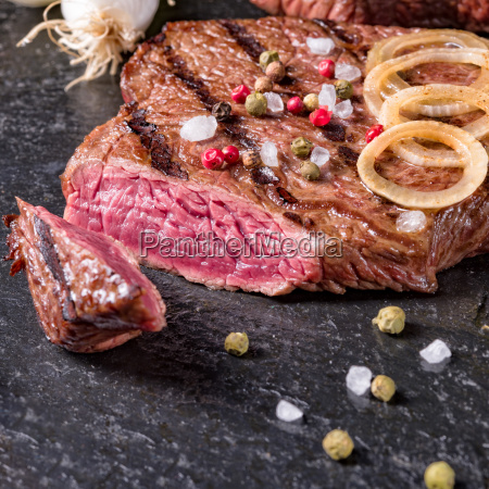 a grilled steak sprinkled with salt