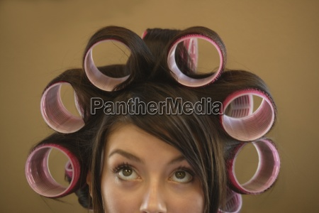 woman with hair rollers in her