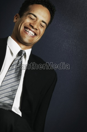 businessman laughs