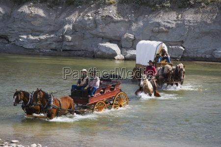 cowboys and a chuck wagon crossing