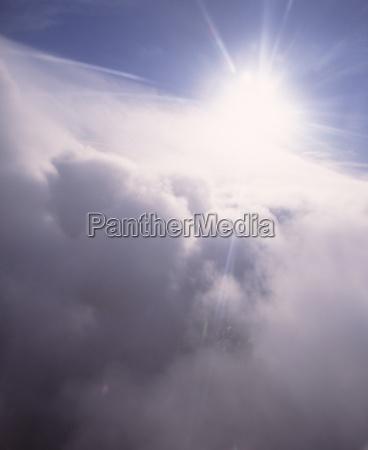 sunburst through cloud tops