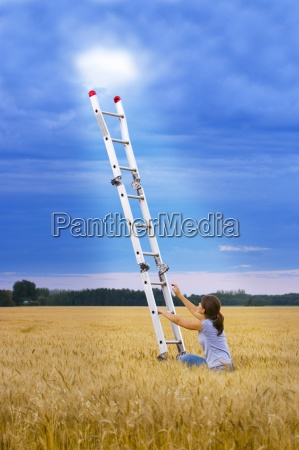 girl climbing ladder to heaven