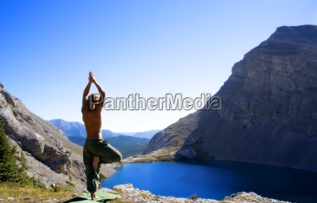 man doing yoga in nature