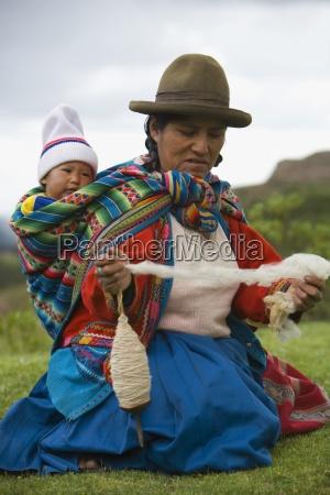 cuzco peru woman spinning alpaca wool