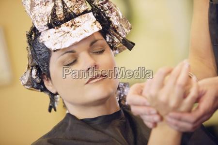 woman having her hair dyed