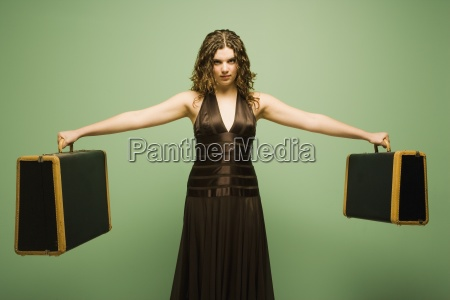 woman holding baggage