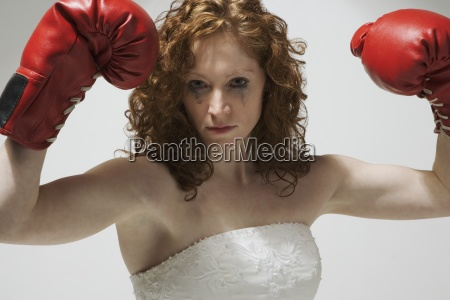 woman in wedding dress with boxing