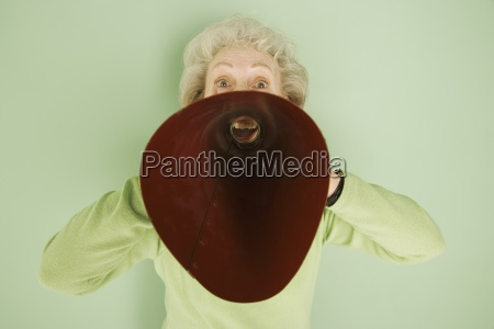 woman shouting into a bullhorn