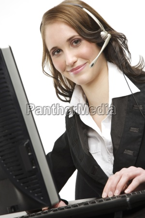 woman wearing a headset and using
