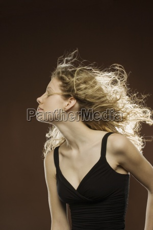 profile of woman with wind blowing