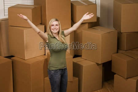 woman standing in front of many