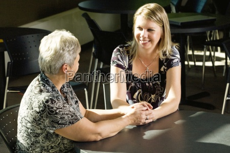 two woman sitting together