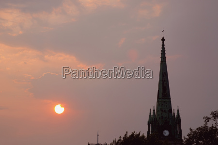 a church steeple at sunset trois