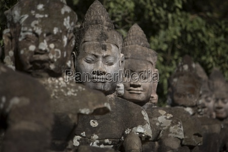 statues lining main gates of ancient