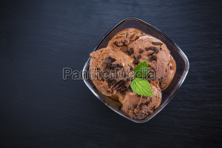 scoops chocolate ice cream in glass