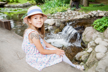 cute happy little girl in nature