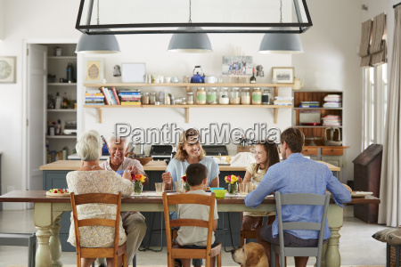 three generation family eating in the