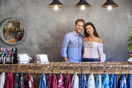 portrait of store owning couple standing