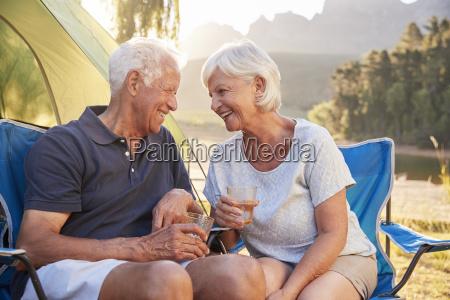senior couple enjoying camping vacation by