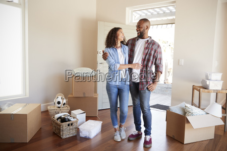 happy couple surrounded by boxes in
